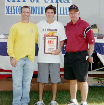 Image of Andrew Corcoran receives the Joe Ficcaro Award for the fastest elite/varsity male runner