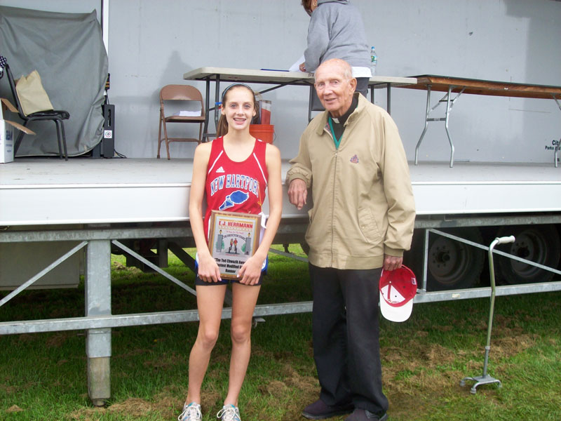 Image of the Ted Chwazik Award award winner Juliet Hull from New Hartford, presented by Monsignor Francis J. Willenburg