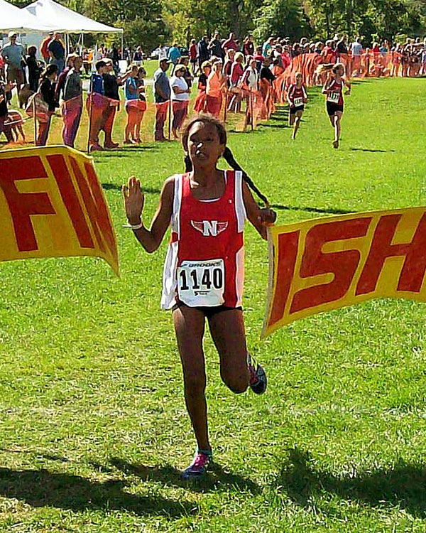 Image of the Utica Police and Fire Fighters Memorial Girls JV race winner Liyat Kebbede from Niskayuna